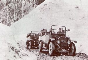 The first two buses over Logan Pass during the Dedication Ceremony July 15, 1933. The first automobile crossed Logan Pass the previous fall. - National Park Service photograph, 1933